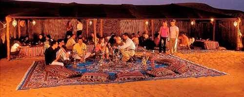 Cena beduina y paseo con camellos